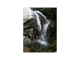 People enjoying in the waterfall at Jhor