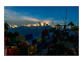 The mountains behind the prayer flags