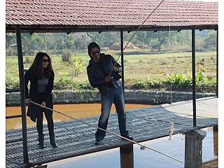 Superstar Rajesh Hamal with his wife fishing on the Pond