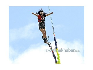 Lady jumping in Pokhara