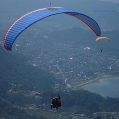 above the fewa lake paragliding
